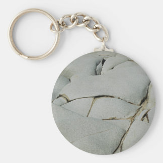An abstract pattern of white and grey. keychain