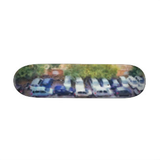 An aerial view of parked cars and bikes skateboard decks