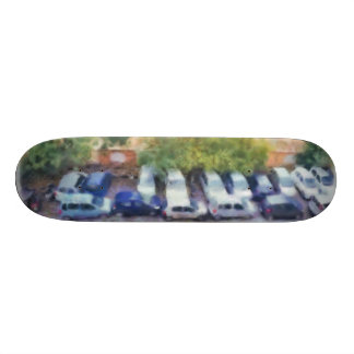 An aerial view of parked cars and bikes skate board decks