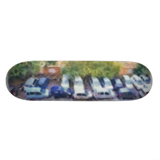 An aerial view of parked cars and bikes skateboard