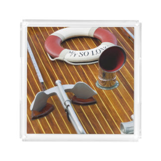 An Anchor And A Life-Buoy On A Wooden Boat Serving Tray