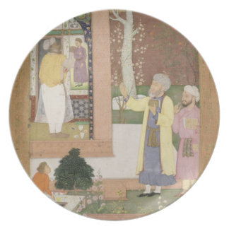 An artist decorating the interior of a garden pavi party plates