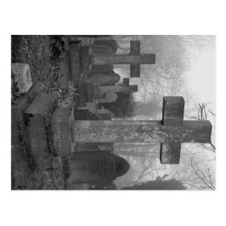 An atmospheric image of a misty graveyard postcard