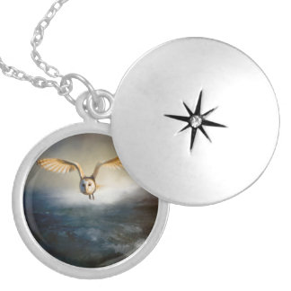 An barn owl flies over the lake locket necklace