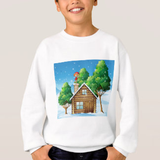 An elf with a gift standing above the house sweatshirt