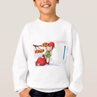 An empty paper beside the elf sweatshirt