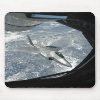 An F-22 Raptor banks away from a KC-135 Mouse Pad