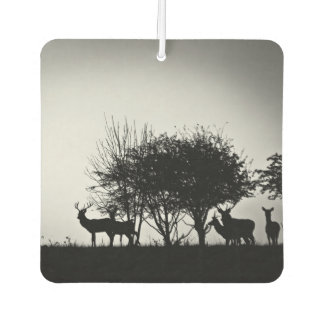An image of some deer in the morning mist car air freshener