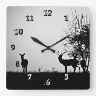 An image of some deer in the morning mist square wall clock