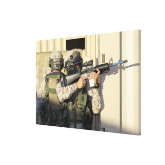 An infantry scout aims his weapon canvas print