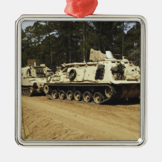 An M-88 recovery vehicle begins to tow an M992 Metal Ornament