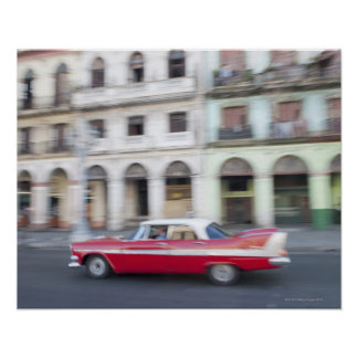 An old car cruising the streets of Havana, Cuba. Posters