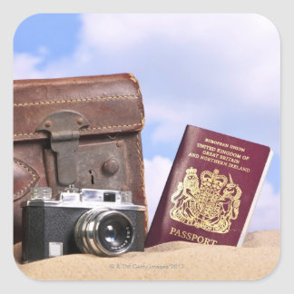 An old leather suitcase, retro camera and square sticker