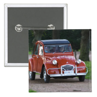An old red Citroen 2CV car with a smiling woman 2 Inch Square Button