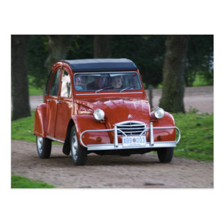 An old red Citroen 2CV car with a smiling woman Postcard