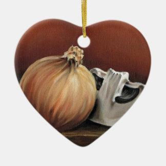 An onion and a mushroom ceramic heart ornament