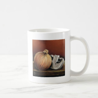 An onion and a mushroom coffee mug