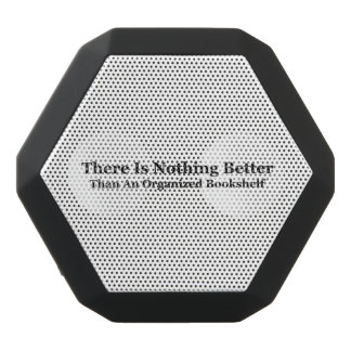 An Organized Bookshelf Black Bluetooth Speaker