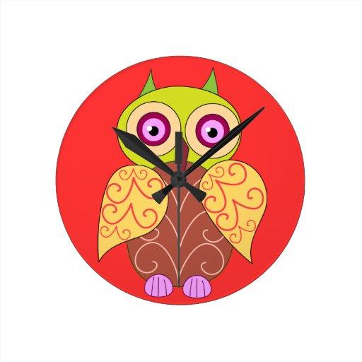 An owl drawing wall clocks