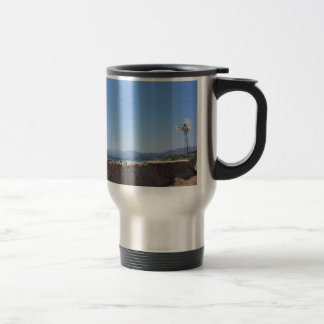 Ancient wall and windmill with seascape travel mug