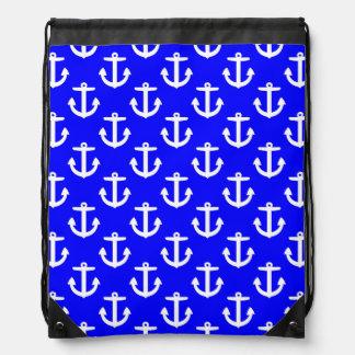 Ancres blanches sur l'arrière - plan bleu sacs à dos