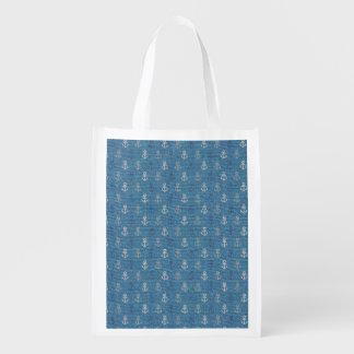 Ancres de toile sur le bleu sac réutilisable d'épcierie