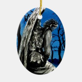 Angel Statue in Winter Ceramic Oval Ornament