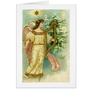 Angel with harp at Christmas tree card
