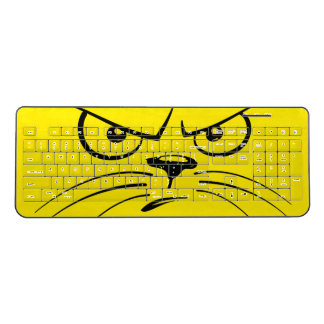 Angry cat face on yellow wireless keyboard