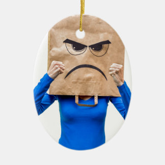 Angry woman showing fists ceramic oval ornament