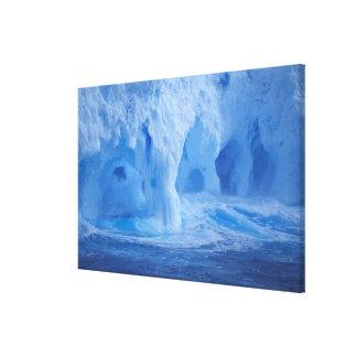 Antarctica. Iceberg with breaking waves Canvas Print