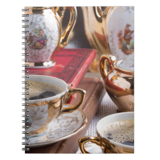 Antique porcelain coffee cups with coffee notebook
