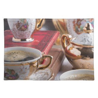 Antique porcelain coffee cups with coffee placemat