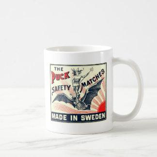 Antique Puck Riding Bat Swedish Matchbox Label Coffee Mug