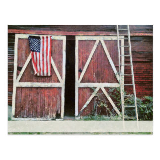 Antique Red Barn Doors With a Flag and Old Ladder Postcard