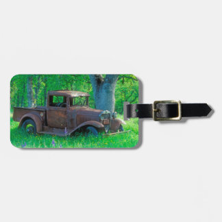 Antique rusted truck in a meadow bag tag