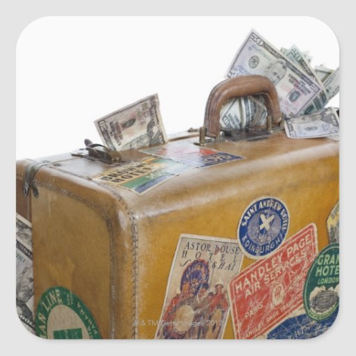 Antique suitcase with protruding money square sticker