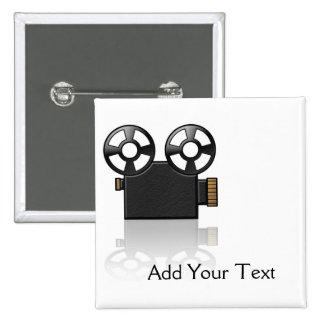 Appareil-photo de film dans le noir et or sur le b badge avec épingle