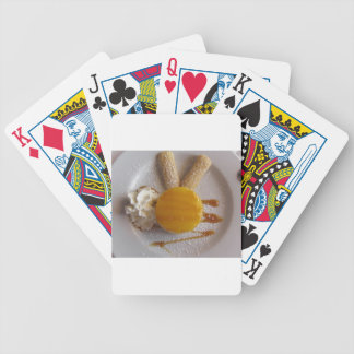 Apricot jam covered ice cream cake bicycle playing cards