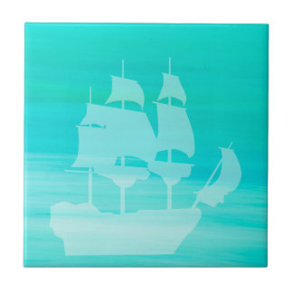 Aquamarine sea water with an old sailboat tile