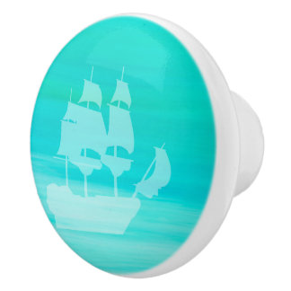 Aquamarine turquoise sea water with a sailing ship ceramic knob