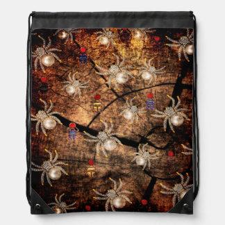Araignées dans le tronçon d arbre sacs avec cordons