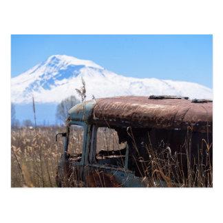 Ararat mountain and rusty bus postcard