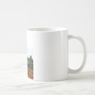 Arches rock sticks it's tongue out coffee mug