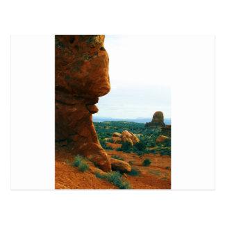 Arches rock sticks it's tongue out postcard