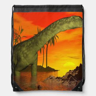 Argentinosaurus dinosaur by sunset - 3D render Drawstring Bag
