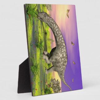 Argentinosaurus dinosaur eating - 3D render Plaque