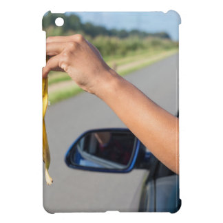 Arm dropping peel of banana out car window cover for the iPad mini
