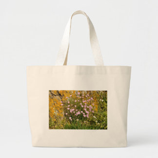 Armeria maritima pink sea growing on a cliff large tote bag