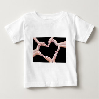 Arms and hands of girls making heart shape baby T-Shirt